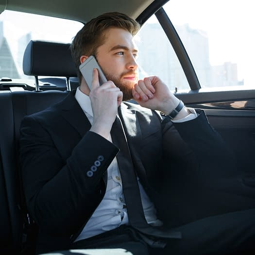 business man on phone in GoRa Taxis